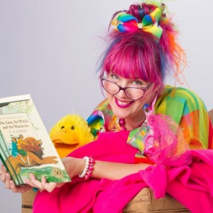 Sparkle reading with baby duck.jpeg